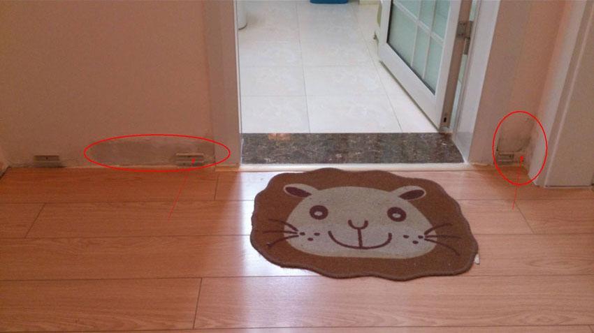 卫生间门口墙皮脱落.jpg